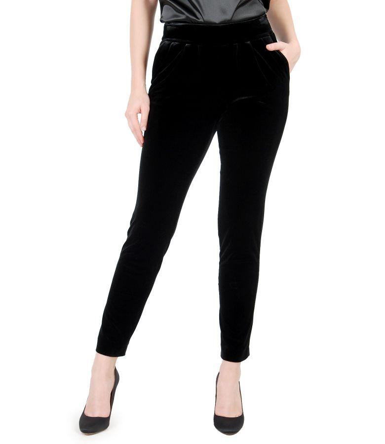 Elastic velvet trousers with pockets