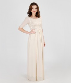 Long evening dress from elastic brocade and veil