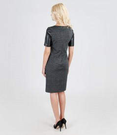 Dress with leather trim and velvet application