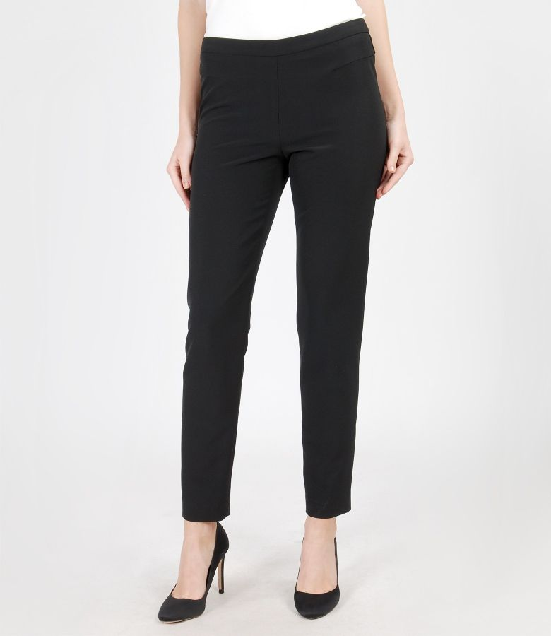 Elastic fabric trousers with metallic zipper