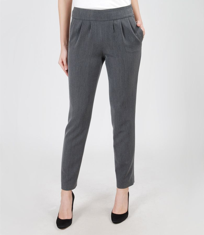 Elastic fabric trousers with pockets