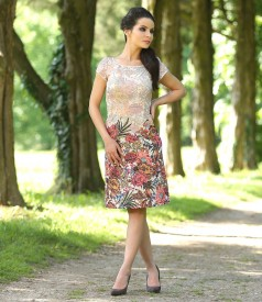 Elegant dress from multicolored elastic brocade with metallic thread