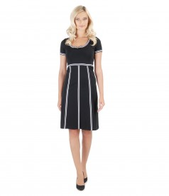 Elastic knit dress with trim