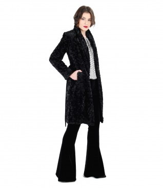 Fur coat and velvet flared pants