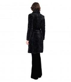 Fur coat and velvet flared pants