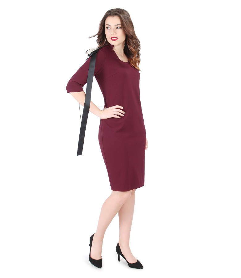 Elastic jersey dress with rips brooch with crystals