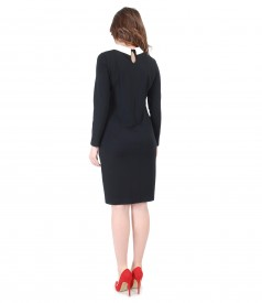 Elegant outfit with elastic knitwear dress and SWAROVSKI crystal brooch