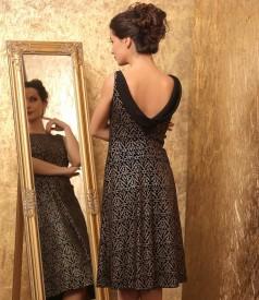Evening dress made of elastic velvet printed with golden motifs