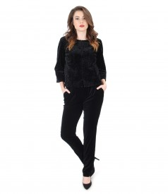 Elegant outfit with jacket and black velvet pants