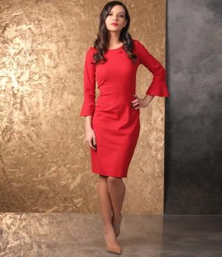 Elegant outfit with elastic jersey dress and velvet envelope bag