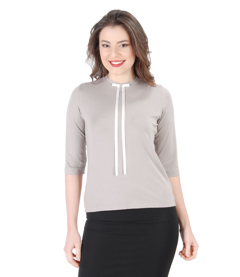 Elegant blouse with bow on decolletage
