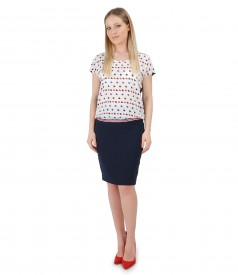 Elegant outfit with printed blouse and tapered skirt