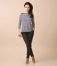Casual outfit with jersey blouse with stripes and pants with lace corner