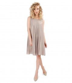 Evening veil dress with pearly effect and epaulettes embellished with crystals