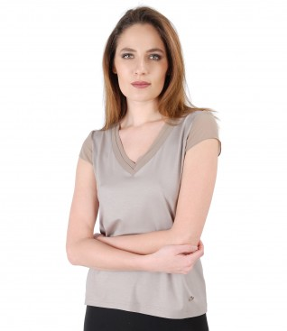 Elastic jersey blouse with trim and veil fins