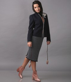 Elegant outfit with jacket with accessory brooch and skirt made of multi-color loops