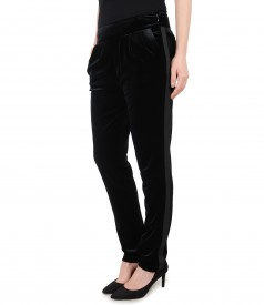 Elastic velvet pants with side pockets