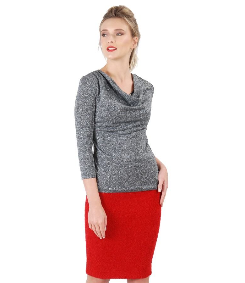 Elegant outfit with skirt made of loops and jersey blouse with folds
