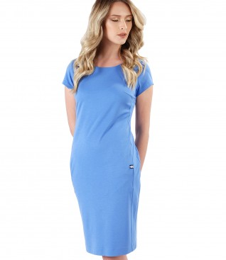Elastic jersey dress with side pockets