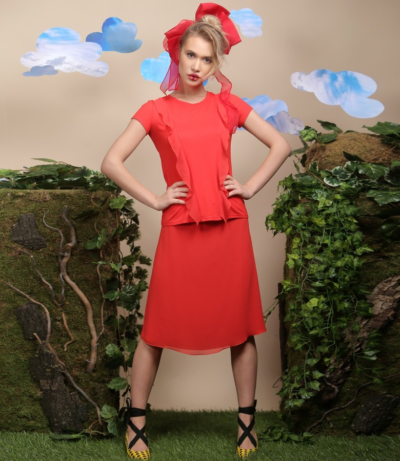 Elegant outfit with veil skirt and jersey blouse with inserts