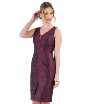Taffeta dress with accessory brooch on decolletage