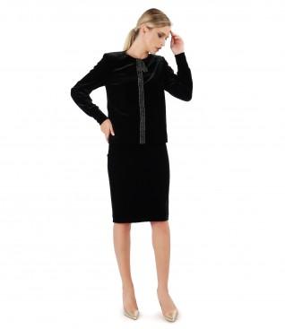 Elegant outfit with jacket and black elastic velvet skirt