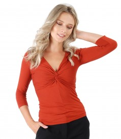 Elastic jersey blouse with node on the bust