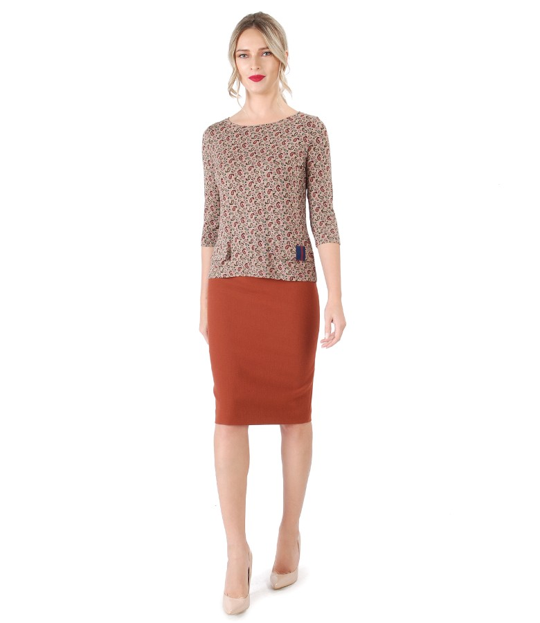 Office outfit with tapered skirt and jerse blouse with decorative flaps