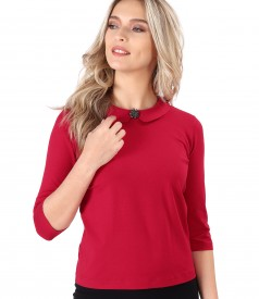 Elastic jersey blouse with round collar with brooch