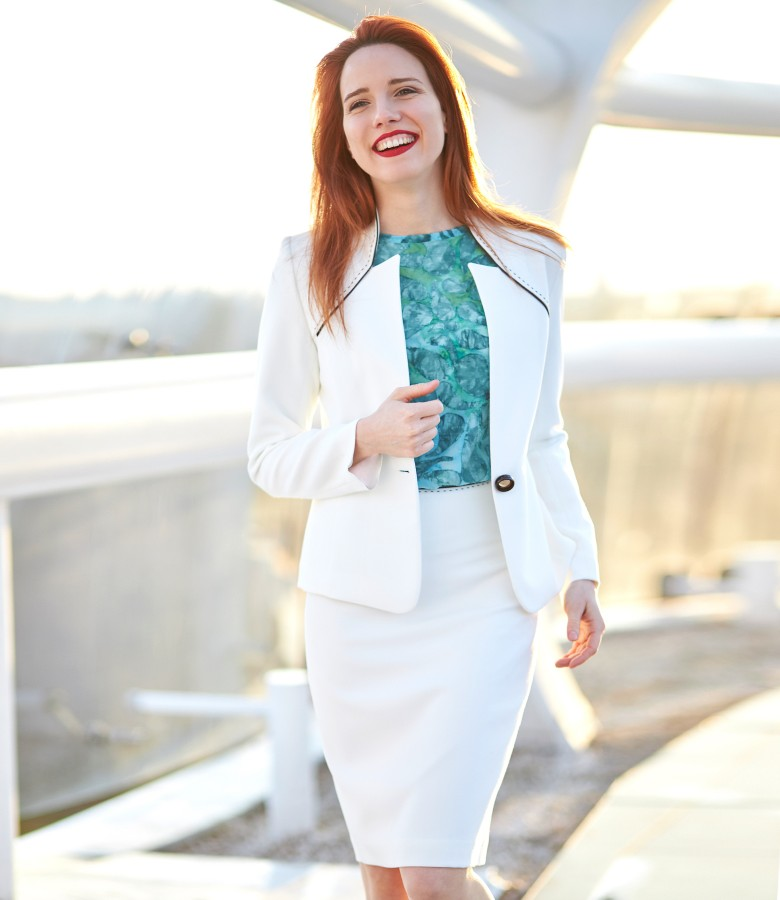 Office woman suit with jacket and skirt made of white elastic fabric
