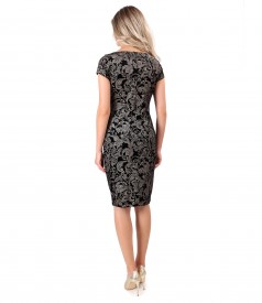 Elastic velvet dress printed with golden motifs