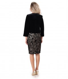 Elegant outfit with velvet dress printed with gold motifs and black velvet bolero