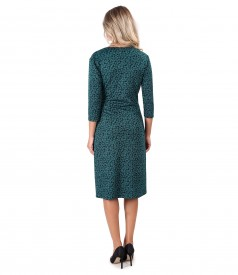 Elastic jersey dress printed with leaves