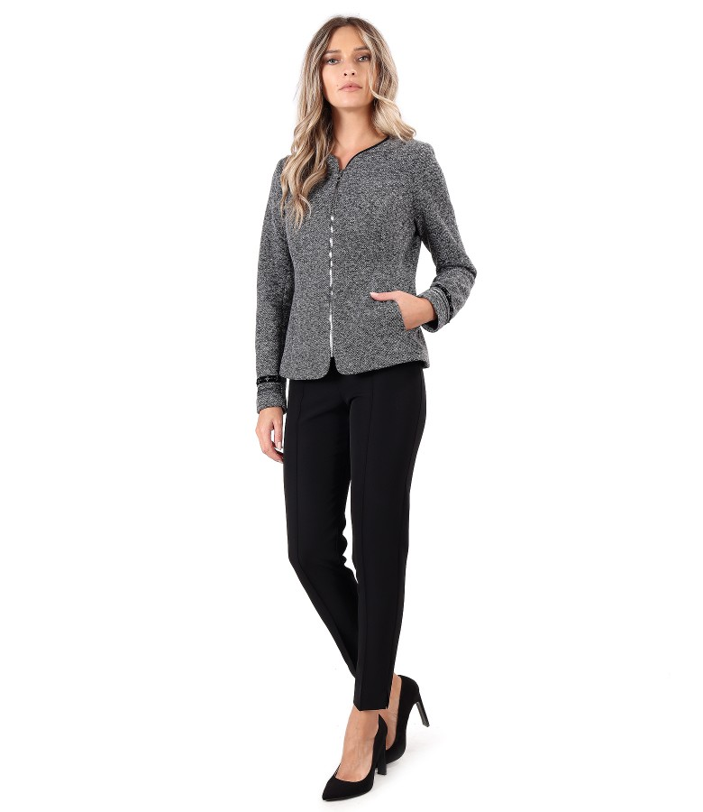 Office outfit with ankle pants and jacket with trimmings on the sleeves