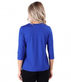 Elastic jersey blouse with rips at the decolletage and sleeve