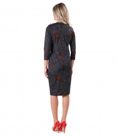 Dress made of thick elastic jersey with floral trimmings on the shoulder