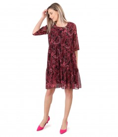 Dress with ruffles made of printed veil with paisley motifs