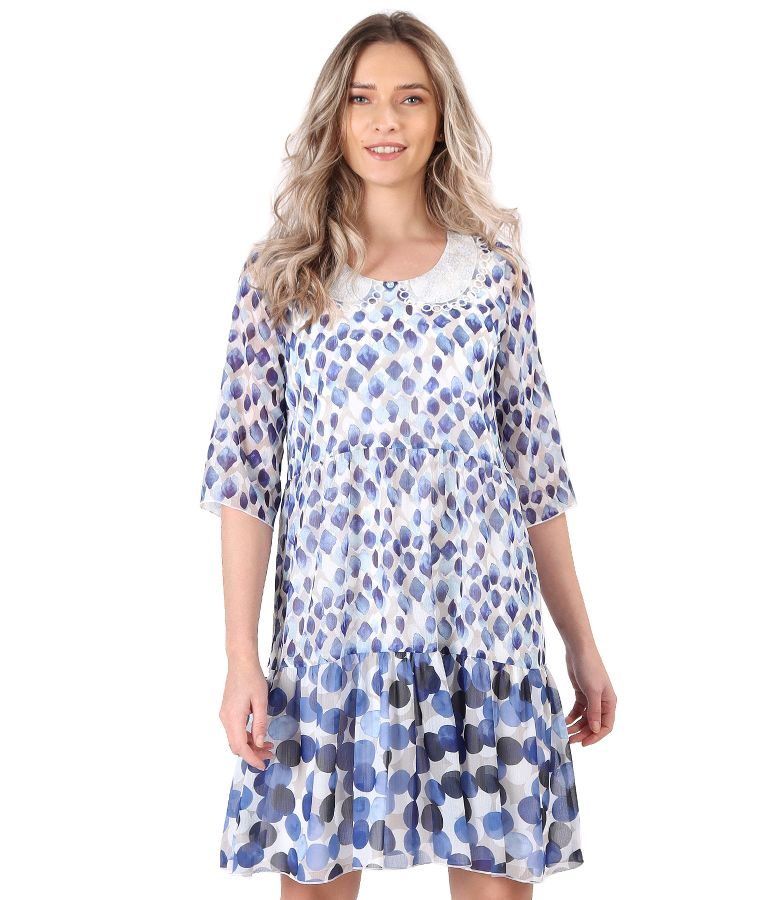 Dress with ruffles made of printed veil