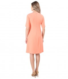Flared office dress with metallic bow at the decolletage