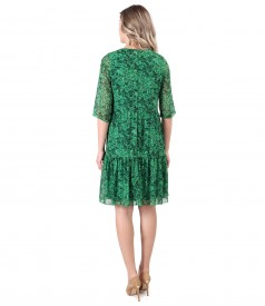 Dress with ruffles made of printed veil with floral motifs