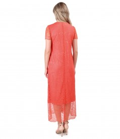 Lace dress with brooch at the neckline